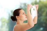 Beautiful woman gets off collagen mask. poster