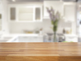 Fototapety Empty wooden table and blurred kitchen background