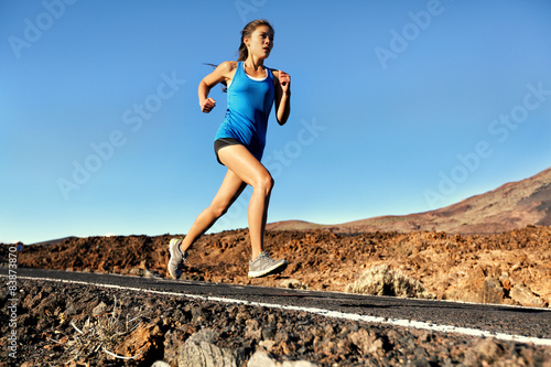 Running sprinting woman - female runner training