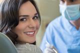 Smiling woman at dentist