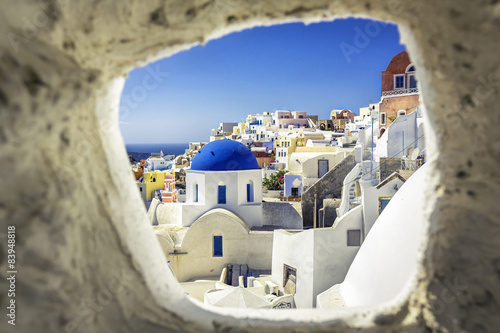 Fotobehang Santorini Santorini blue dome church look through the chimney, Greece