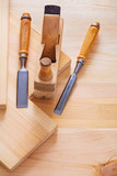 old fashioned woodworkers plane and joinery chisels on wooden bo poster