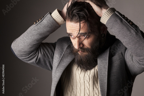 portrait of a sad young man with a beard and mustache Poster