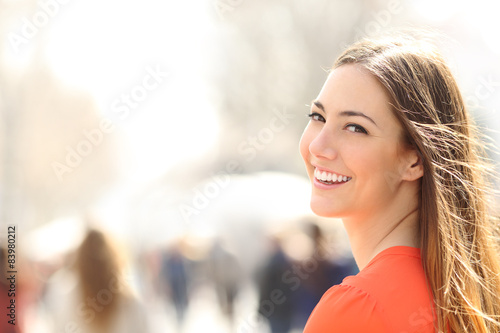 Beauty woman with perfect smile and white teeth on the street - 83980212