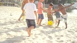 Kids playing soccer on a beach in Brazil