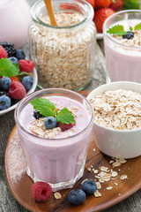 berry smoothie with oatmeal in a glass, vertical