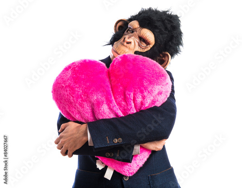 Poster Monkey man holding a big heart