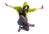 Fototapety Teenager girl jumping in street dance style