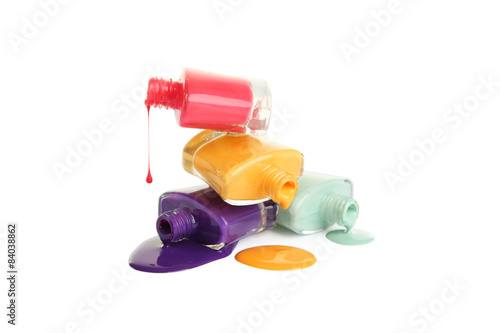 Colorful nail polish isolated on white