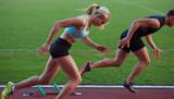 Fototapeta athlete woman group  running on athletics race track