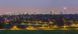 Panoramic view of London from Primrose Hill park at dusk.