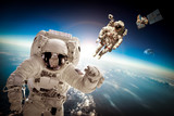 Fototapeta Astronaut in outer space