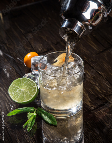 Poster Pouring a cocktail into glass