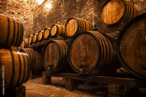 Fototapeta cellar with barrels for storage of wine, Italy