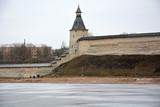 Pskov Krom. View from the river Velikaya. Spring season poster