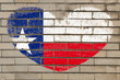 heart shape flag of texas on brick wall