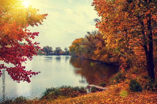 Rural landscape at sunset. Lake in autumn