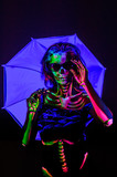 Skeleton bodyart with blacklight studio portrait poster