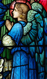 Praying angel in a stained glass window