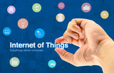 Hand holding Internet of things (IoT) word and object icon and b poster