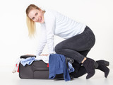 Woman packs overcrowded bag for holiday poster