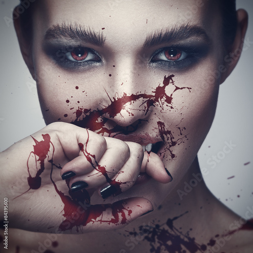 Vampire woman with blood on her face Poster