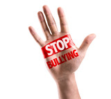 Open hand raised with the text: Stop Bullying poster