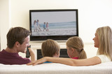 Family Watching Widescreen TV At Home - 84418672