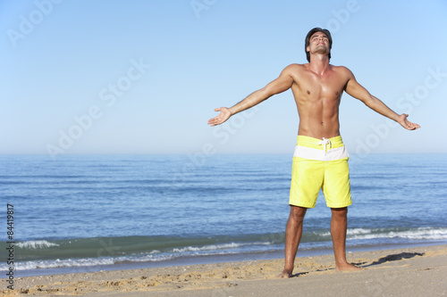 Poster Young Man Standing On Summer Beach