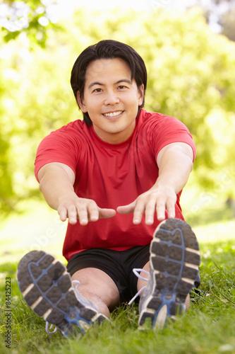 Asian man exercising