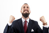 Hombre de negocios con traje y pañuelo con gesto triunfal