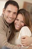 Portrait 30s couple hugging indoors poster
