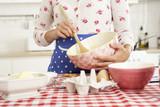 Fototapety Woman Baking In Kitchen