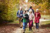 Fototapety Multl Generation Family Walking Along Autumn Path