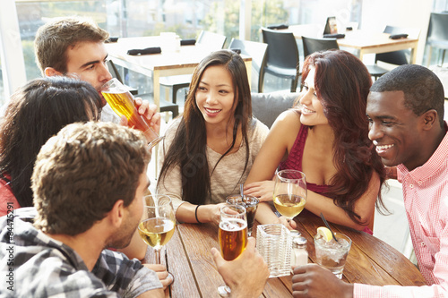 Juliste Group Of Friends Enjoying Drink At Outdoor Rooftop Bar