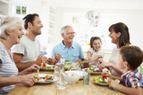 Fototapety Multi Generation Family Eating Meal Around Kitchen Table