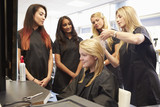 Fototapety Teacher Helping Students Training To Become Hairdressers