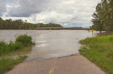 A pathway flooded by the water of the Bow River at Fish Creek Park during the 2013 Calgary Flood.