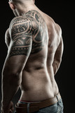 Muscular man from the back - black and white photo