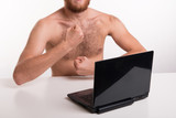 Man showing chest in front of webcam