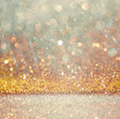 glitter vintage lights background. light gold and silver.