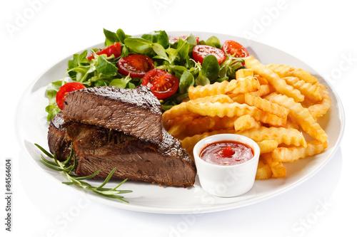 Deurstickers Klaar gerecht Grilled steak, French fries and vegetables on white background