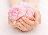 Fototapety french manicure with rose flowers. spa