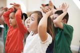 Fototapety Group Of Children Enjoying Drama Class Together