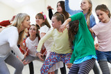 Fototapety Group Of Children With Teacher Enjoying Drama Class Together