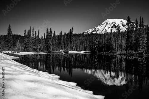 Mt Rainier in winter reflection in lake Poster