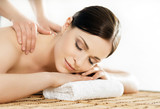 Fototapety Young and healthy woman in spa salon. Traditional Swedish massage therapy and beauty treatments.