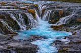 Fototapety Brúarfoss (Bridge Fall), is a waterfall on the river Brúará in southern Iceland where a series of small runlets of water runs into a beautiful, turquoise-blue colored pool.