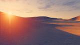 Sun sets behind the desert dunes