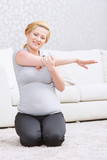 Pregnant woman doing exersices poster